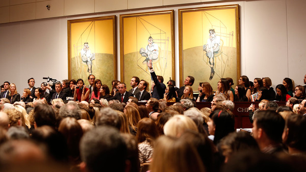The record-breaking Christie's auction in November last year where Francis Bacon's 'Three Studies of Lucian Freud' sold for $142.4m ©Christie's