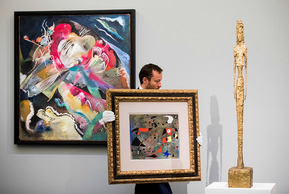 From left to right: Wassily Kandinsky, Bild mit weissen Linien (Painting with White Lines), 1913. Joan Miró, Femme et oiseaux, 1940. Alberto Giacometti, Grande figure, bronze, 1947. Image Courtesy of Sotheby's